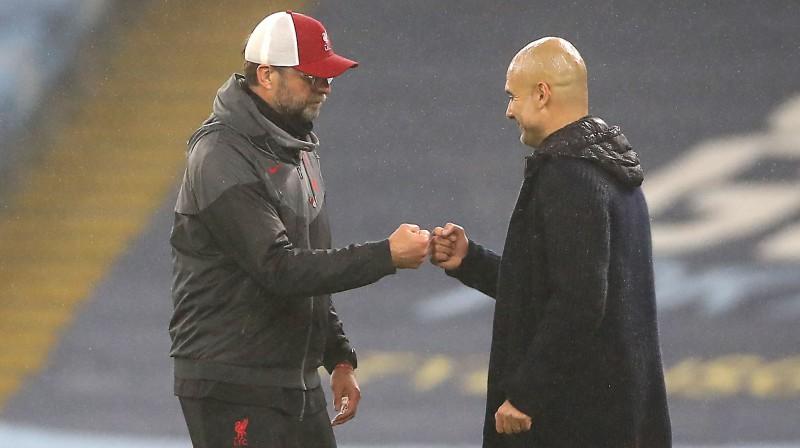 Jirgens Klops un Peps Gvardiola. Foto: PA/Scanpix